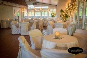 A view of the indoor area setup for a wedding reception at The Manor, a wedding venue located near Lafayette, Louisiana.