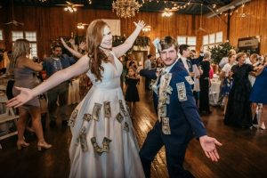 A bride and groom for their money dance at The Madison a wedding venue near Lafayette, Louisiana.