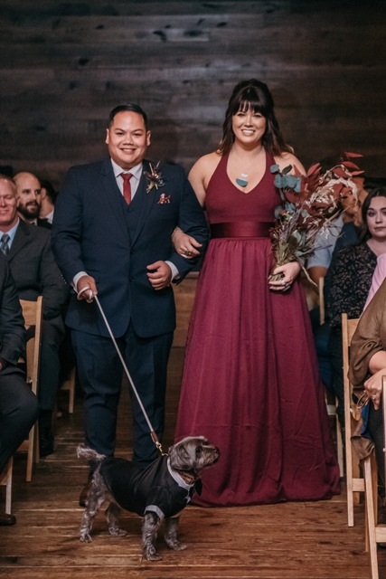 A dog walking down the aisle for a wedding.
